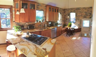 Open, super-modern kitchen with heated floors and fossil counter tops
