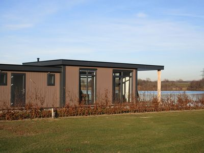 Photo for Spacious chalet with a view of the water, located in holiday park with sandy beach