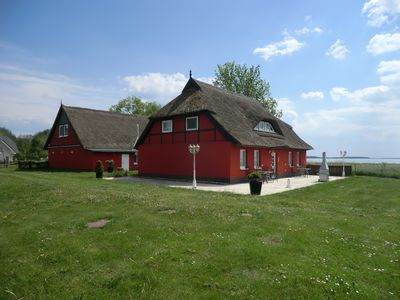 Photo for Nice apartment in the thatched roof house directly at the reed belt of the water