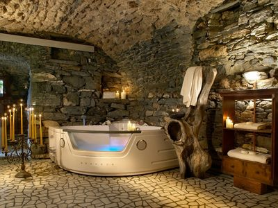 Photo for Characteristic stone Chalet with panoramic saunas and cave with heated jacuzzi