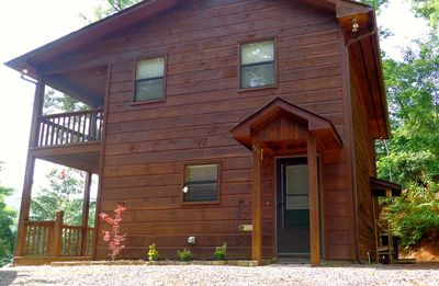 Gorgeous wood side cabin welcomes you at the top of the driveway.