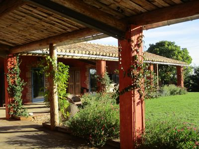 Photo for Beautiful character house, rated 5 stars, heated pool, terrace, garden, near Uzè