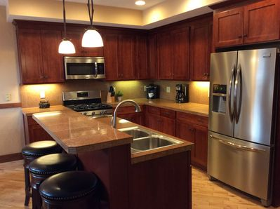 Custom, updated kitchen with granite, hardwood and stainless steel appliances.