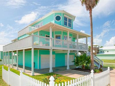 Photo for Turquoise Treasure! Steps away from the beach & across from the pool