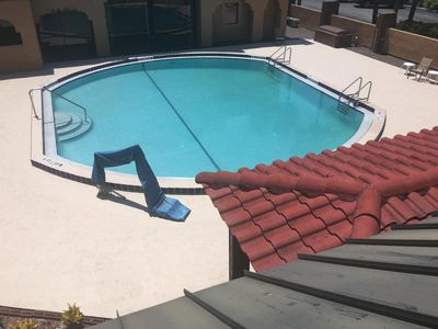 Swimming pool, poolside loungers and picnic tables