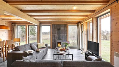 Photo for TraumHaff Cozy coastal chalet entirely made of larch wood with fireplace and sauna Baltic Sea