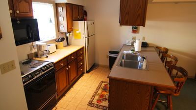 KItchen with breakfast bar includes dishwasher & microwave