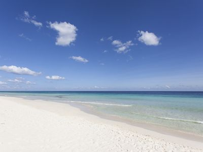 soft white sand and clear Caribbean in front of the house