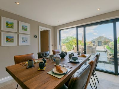 Dining area with full length patio doors into the garden