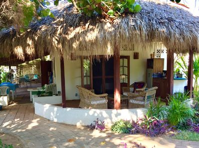 Frida's private patio and kitchenette. Left is the covered porch pool side.