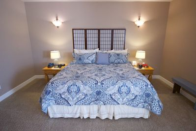 Luxurious king-size bed with fine bedding complete with his & her night stands.