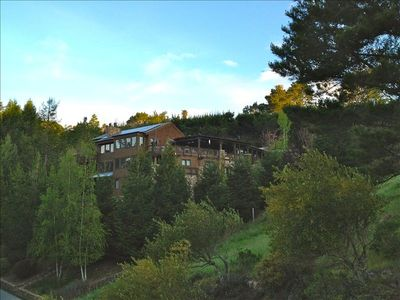 Our Lodge Style Hillside Residence. Stone and wood clad. Extensively Landscaped with pathways and gardens throughout. Very separate from neighbors. Our lot and adjacent open space parcel total 3.5 acres.