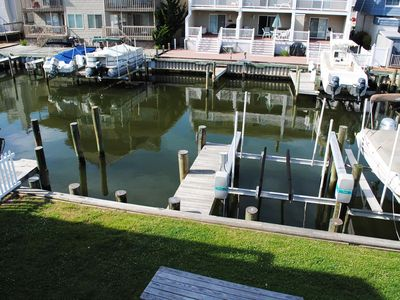 Photo for Cute, stylish 3 bedroom condo with free WiFi and a boat dock located in peaceful midtown right on the bay water and eight blocks to the beach!