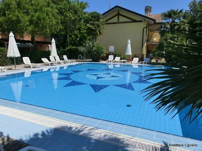 Photo for Luminous terraced villa with private garden in village with swimming pool.