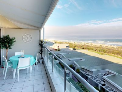 Photo for Beachfront condo with beach access, shared pool, balcony and ocean views