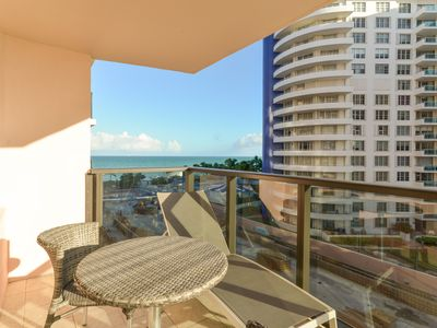 Photo for Oceanfront resort condo w/ balcony, 2 shared pools, gym & private beach access!