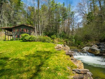 Photo for Cabin on Trout River, 9 Acres Surrounded by US Forest, Waterfalls, 100% Secluded