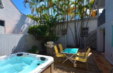 Photo for Dog-friendly home w/ patio and private hot tub - walk to the beach!