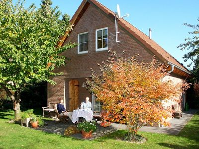 Photo for A detached, four-star holiday home with a spacious garden and many leisure activities.