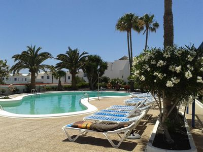 Photo for Sleeps 2/4, Sea View. WiFi. Beach 400 meters. Peaceful gated complex with Pool
