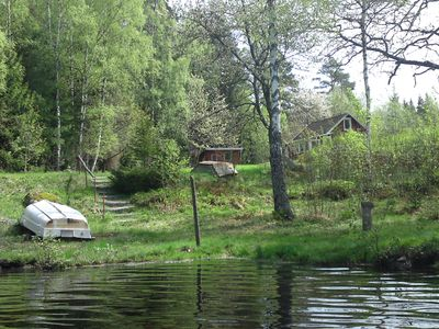 Photo for Holiday home right on the lake with a large lake property