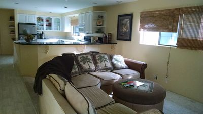 Living room is open and inviting, large flat screen tv,