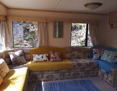 Bright and colourful living area with lots of space for everyone