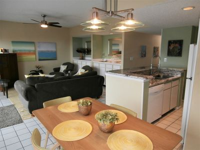New granite counters in kitchen. Open floor plan offers plenty of room to fit the entire family.
