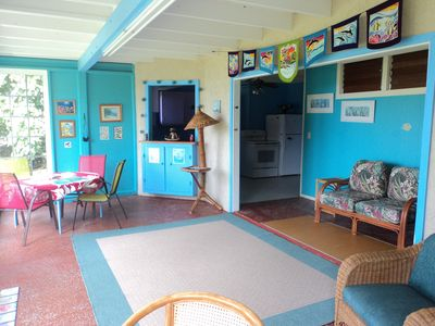 The lanai (living room/patio area)  is brightly decorated in an ocean theme.