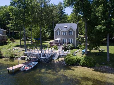 Photo for Stunning waterfront home on Lake Winnipesaukee, with private beach access and boat dock.