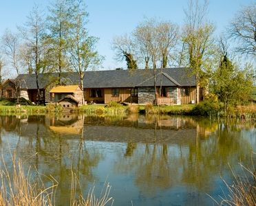 Photo for 3 Stunning lakeside cottages with indoor pool/hot tub + outdoor hot tub, fishing