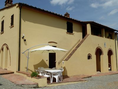 Photo for A small village of five beautiful apartments in the green Tuscan hills