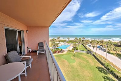 Take in the scenic views overlooking the community pool area, beach and ocean.
