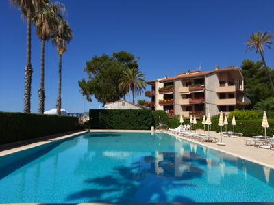 Photo for Nice studio with a terrace overlooking the sea and a communal swimming pool, and a tennis court