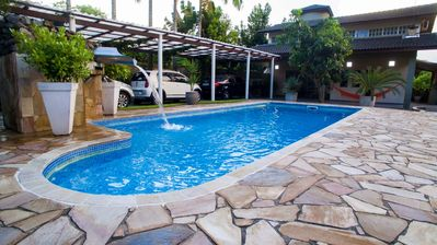 Photo for 4 bedroom house (3 suites), wifi, cable TV, kitchen, pool and gourmet space