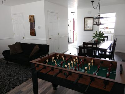 Enjoy playing, gathering, & relaxing around the large table, foosball, or couch.