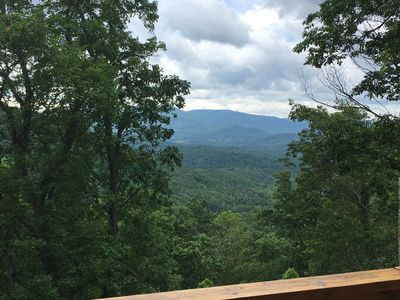 Photo for Top of the world views! Log Cabin, hot tub, fireplace, 18 min to downtown.