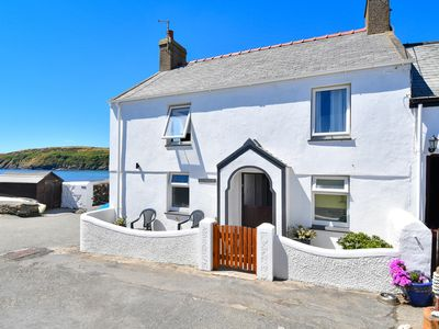 Photo for A white painted traditional beach side cottage in the pretty village of Aberdaron, near cafes, shops