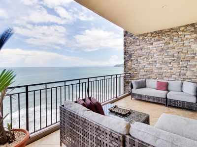 Photo for Tranquil oceanfront escape with sweeping views, pools, and fitness center