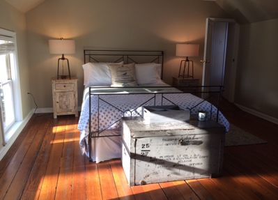 Sunshine & country touches in the master bedroom, with an adjoining master bath.