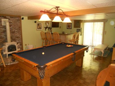 Pool Table And Bar With Gas Stove.