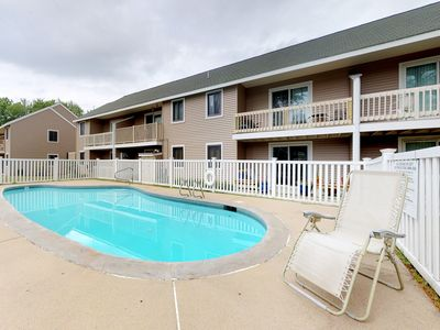 Photo for Mountain view condo w/ balcony & shared pool - ideal for skiing, shopping, more!