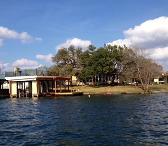 View of Shady Oaks lake house and boat dock from the lake.