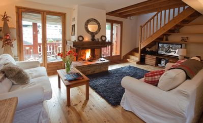 First floor. Cozy open space with living room, kitchen and fireplace.