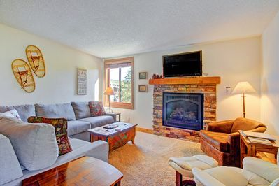 Additional view of living area with gas fireplace