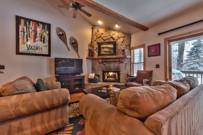 """Living Room with Comfortable Furnishings, 50"""" Smart TV with Xfinity Cable, Gas Fireplace and Private Balcony Access"""