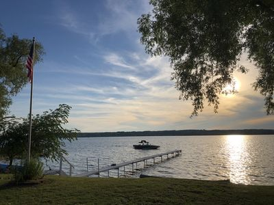 Photo for Beach Front Lake Leelanau Cottage with Stunning Sun Set Views. 10 Miles from TC