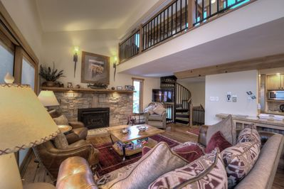 Large living area with room for the family and cosy fire place
