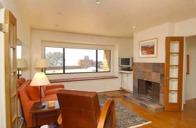 Master includes sitting area with fireplace - a great getaway with an ocean view