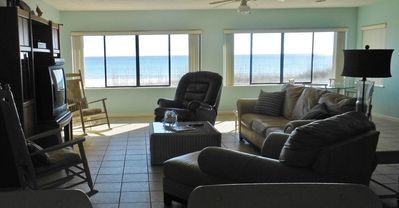 Now this is a beach house!  Deck in the sand, amazing views!  (new TV not shown)